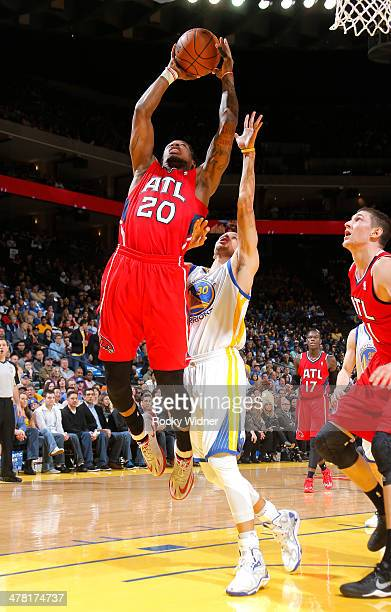 Cartier Martin of the Atlanta Hawks drives to the basket against the Golden State Warriors on March 7 2014 at Oracle Arena in Oakland California NOTE...