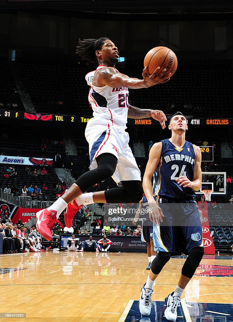 <a gi-track='captionPersonalityLinkClicked' href=/galleries/search?phrase=Cartier+Martin&family=editorial&specificpeople=834581 ng-click='$event.stopPropagation()'>Cartier Martin</a> #20 of the Atlanta Hawks glides to the hoop against the Memphis Grizzlies on October 20, 2013 at Philips Arena in Atlanta, Georgia.