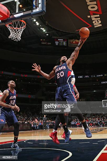 Cartier Martin of the Atlanta Hawks grabs a rebound against the Washington Wizards at the Verizon Center on November 30 2013 in Washington DC NOTE TO...