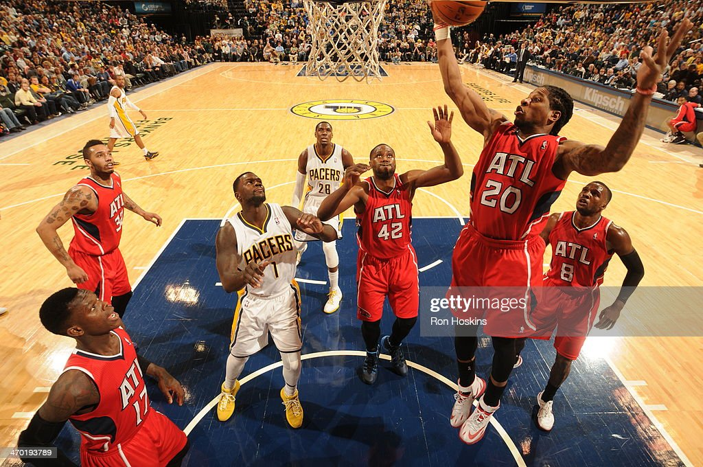 <a gi-track='captionPersonalityLinkClicked' href=/galleries/search?phrase=Cartier+Martin&family=editorial&specificpeople=834581 ng-click='$event.stopPropagation()'>Cartier Martin</a> #20 of the Atlanta Hawks grabs a rebound against the Indiana Pacers at Bankers Life Fieldhouse on February 18, 2014 in Indianapolis, Indiana.