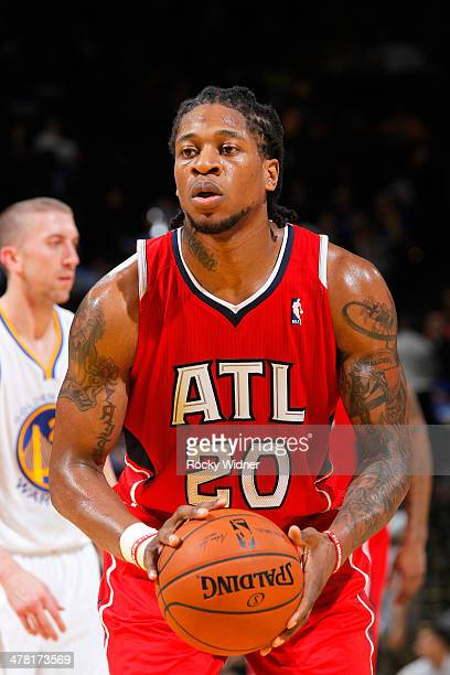 Cartier Martin of the Atlanta Hawks shoots a free throw against the Golden State Warriors on March 7 2014 at Oracle Arena in Oakland California NOTE...
