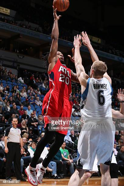 Cartier Martin of the Atlanta Hawks shoots against the Minnesota Timberwolves on March 26 2014 at Target Center in Minneapolis Minnesota NOTE TO USER...