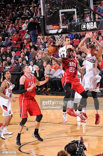 Cartier Martin of the Atlanta Hawks shoots against the Portland Trail Blazers on March 5 2014 at the Moda Center Arena in Portland Oregon NOTE TO...