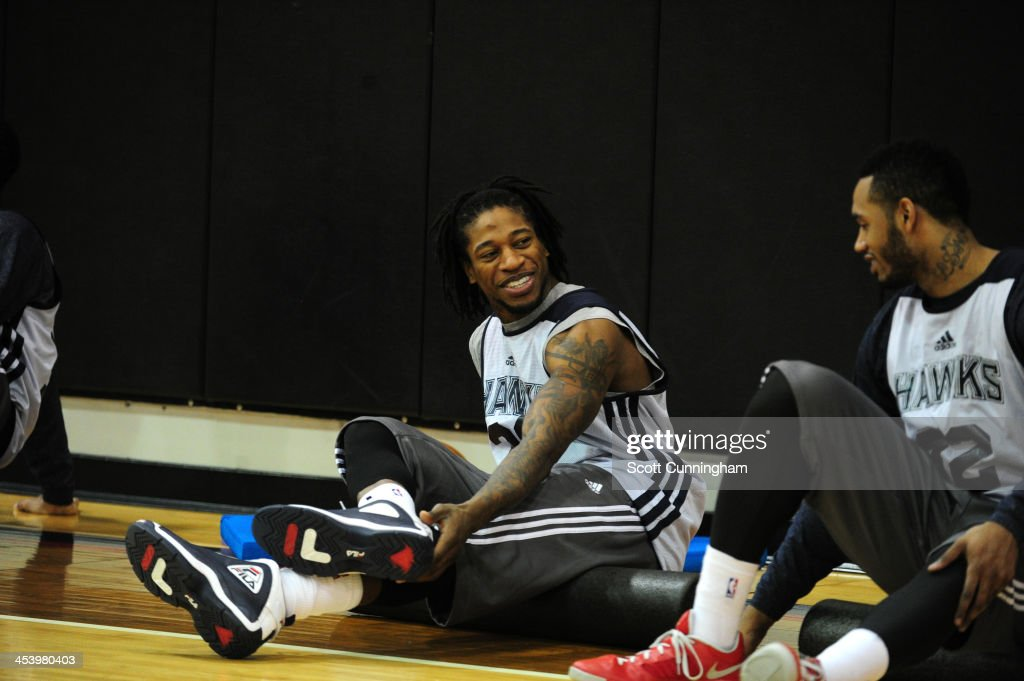 <a gi-track='captionPersonalityLinkClicked' href=/galleries/search?phrase=Cartier+Martin&family=editorial&specificpeople=834581 ng-click='$event.stopPropagation()'>Cartier Martin</a> #20 of the Atlanta Hawks smiles during practice on December 5, 2013 at Philips Arena in Atlanta, Georgia.