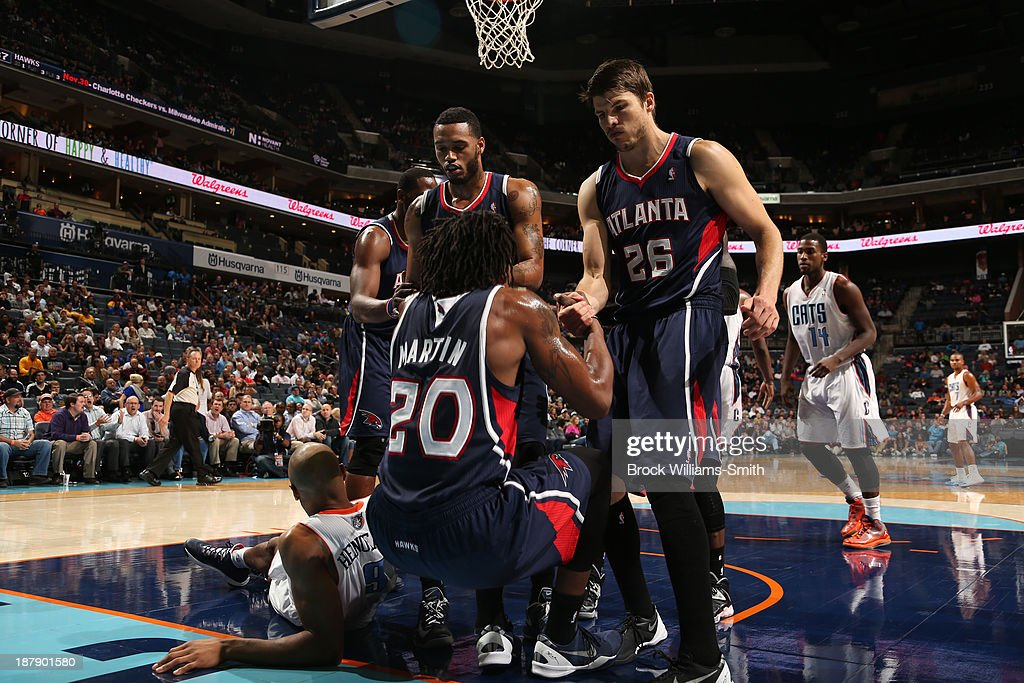 <a gi-track='captionPersonalityLinkClicked' href=/galleries/search?phrase=Cartier+Martin&family=editorial&specificpeople=834581 ng-click='$event.stopPropagation()'>Cartier Martin</a> #20 of the Charlotte Bobcats gets a hand from teammates during the game against the Atlanta Hawks at the Time Warner Cable Arena on November 11, 2013 in Charlotte, North Carolina.