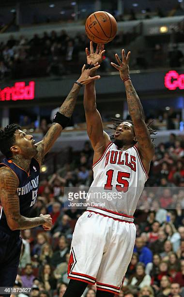 Cartier Martin of the Chicago Bulls shoots over Chris DouglasRoberts of the Charlotte Bobcats at the United Center on January 11 2014 in Chicago...