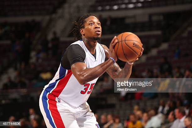 Cartier Martin of the Detroit Pistons shoots a free throw against the Philadelphia 76ers during the preseason game on October 23 2014 at The Palace...