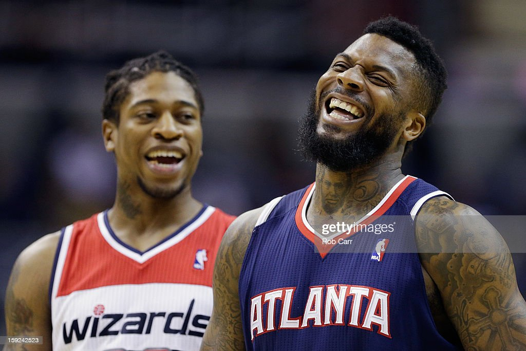 <a gi-track='captionPersonalityLinkClicked' href=/galleries/search?phrase=Cartier+Martin&family=editorial&specificpeople=834581 ng-click='$event.stopPropagation()'>Cartier Martin</a> #20 of the Washington Wizards and DeShawn Stevenson #92 of the Atlanta Hawks joke around during the second half of their game at Verizon Center on December 18, 2012 in Washington, DC.
