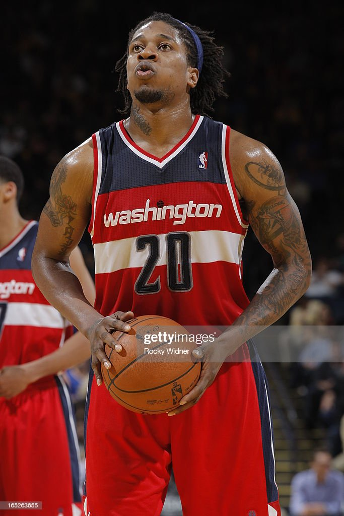 <a gi-track='captionPersonalityLinkClicked' href=/galleries/search?phrase=Cartier+Martin&family=editorial&specificpeople=834581 ng-click='$event.stopPropagation()'>Cartier Martin</a> #20 of the Washington Wizards attempts a free throw against the Golden State Warriors on March 23, 2013 at Oracle Arena in Oakland, California.
