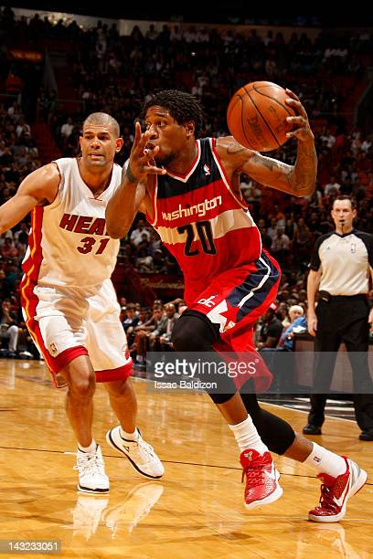 Cartier Martin of the Washington Wizards drives against Shane Battier of the Miami Heat during the game between the Miami Heat and the Washington...