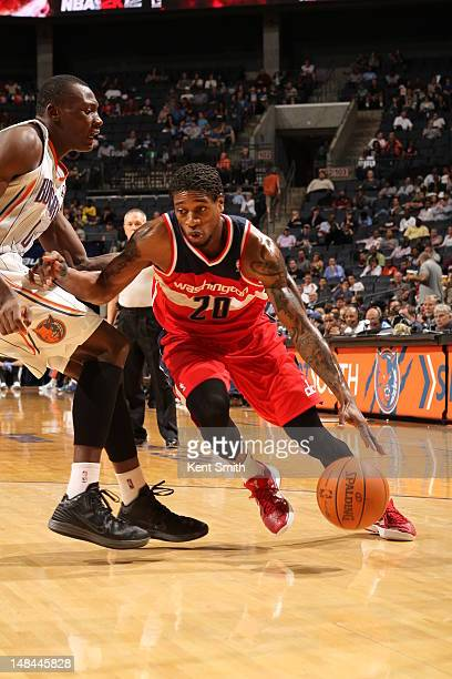 Cartier Martin of the Washington Wizards drives to the basket against the Charlotte Bobcats during the game at the Time Warner Cable Arena on April 9...