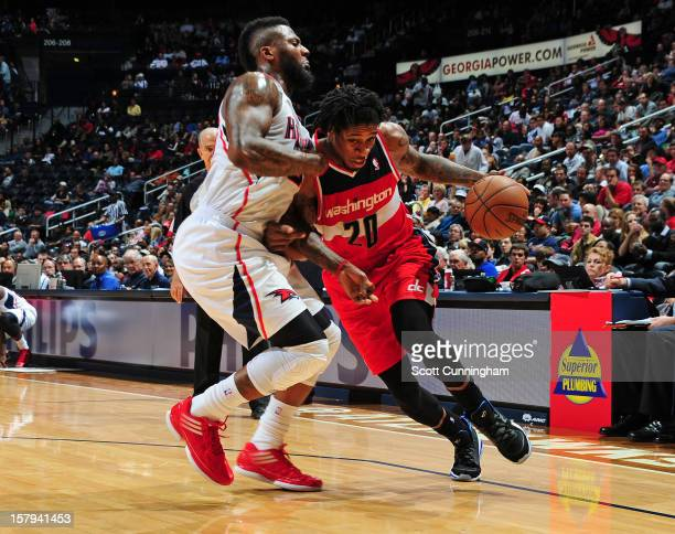 Cartier Martin of the Washington Wizards drives to the basket against the Atlanta Hawks at Philips Arena on December 2012 in Atlanta Georgia NOTE TO...
