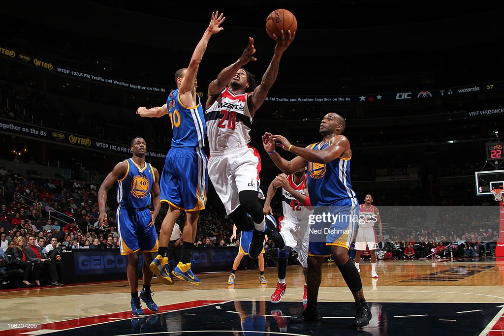 <a gi-track='captionPersonalityLinkClicked' href=/galleries/search?phrase=Cartier+Martin&family=editorial&specificpeople=834581 ng-click='$event.stopPropagation()'>Cartier Martin</a> #20 of the Washington Wizards drives to the basket against Stephen Curry #30 of the Golden State Warriors on December 8, 2012 at the Verizon Center in Washington, DC.