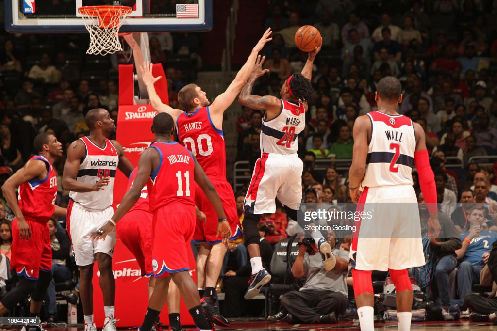 <a gi-track='captionPersonalityLinkClicked' href=/galleries/search?phrase=Cartier+Martin&family=editorial&specificpeople=834581 ng-click='$event.stopPropagation()'>Cartier Martin</a> #20 of the Washington Wizards drives to the basket against the Philadelphia 76ers at the Verizon Center on April 12, 2013 in Washington, DC.