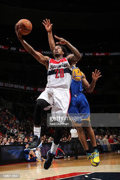 Cartier Martin of the Washington Wizards goes to the basket against Jarrett Jack of the Golden State Warriors during the game at the Verizon Center...