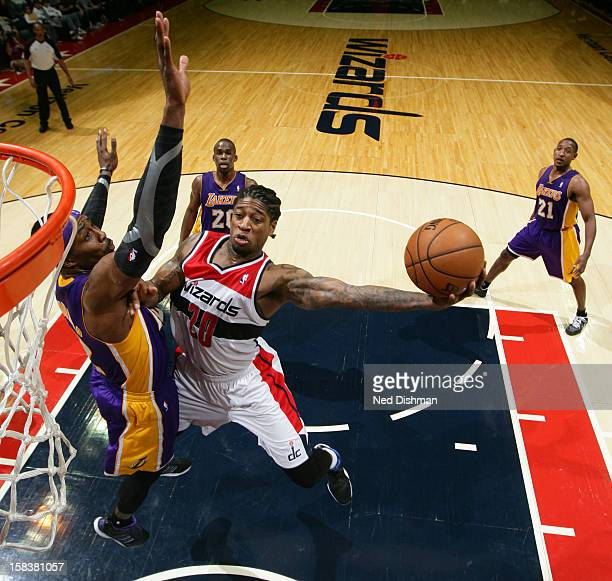 Cartier Martin of the Washington Wizards goes to the basket against Dwight Howard of the Los Angeles Lakers during the game at the Verizon Center on...