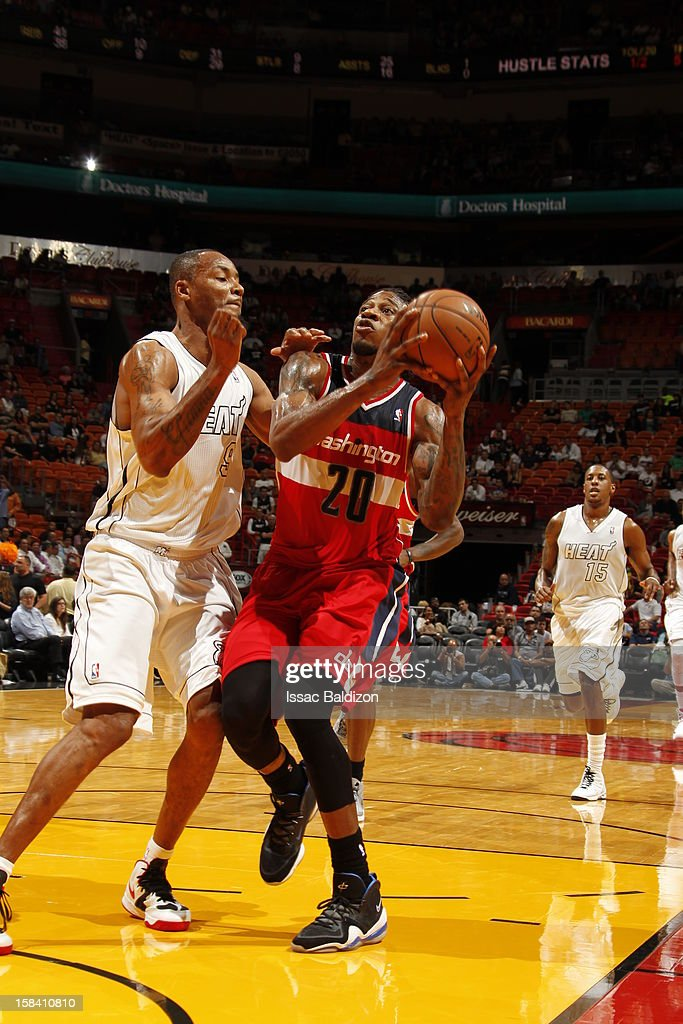 Cartier Martin #20 of the Washington Wizards goes to the basket against Rashard Lewis #9 of the Miami Heat during a game between the Washington Wizards and the Miami Heat on December 15, 2012 at American Airlines Arena in Miami, Florida.