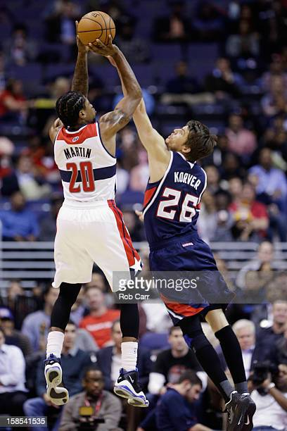 Cartier Martin of the Washington Wizards puts up a shot over Kyle Korver of the Atlanta Hawks during the first half at Verizon Center on December 18...