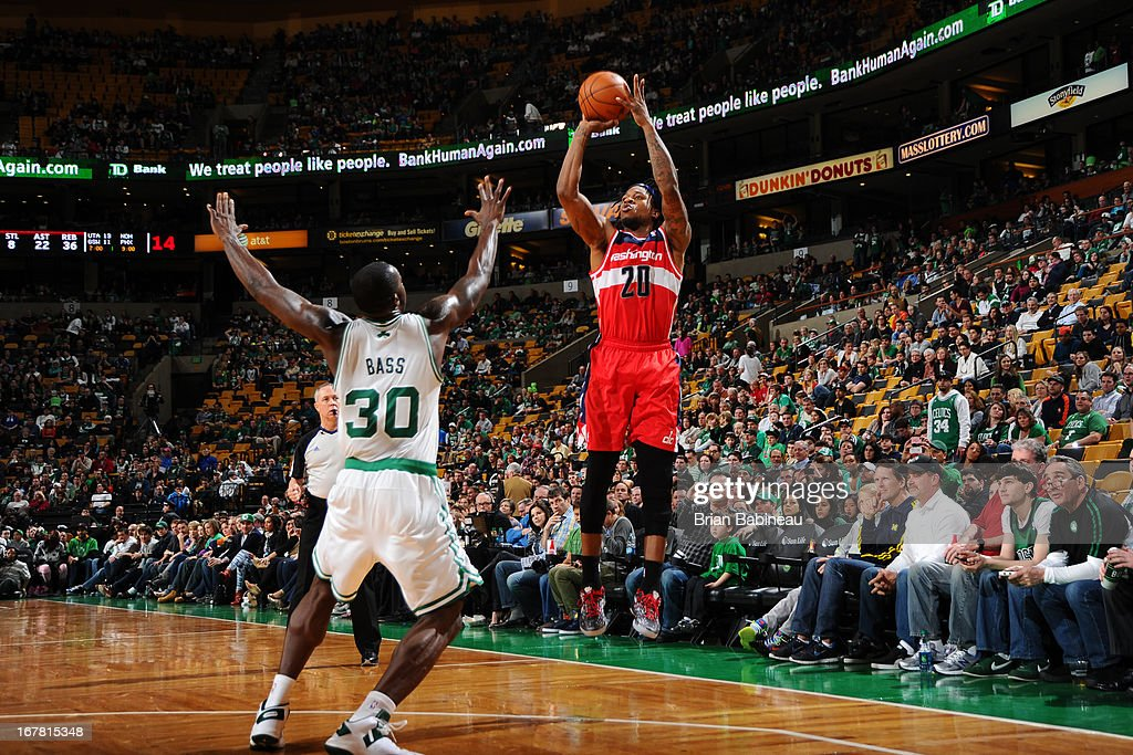 <a gi-track='captionPersonalityLinkClicked' href=/galleries/search?phrase=Cartier+Martin&family=editorial&specificpeople=834581 ng-click='$event.stopPropagation()'>Cartier Martin</a> #20 of the Washington Wizards shoots against <a gi-track='captionPersonalityLinkClicked' href=/galleries/search?phrase=Brandon+Bass&family=editorial&specificpeople=233806 ng-click='$event.stopPropagation()'>Brandon Bass</a> #30 of the Boston Celtics on April 7, 2013 at the TD Garden in Boston, Massachusetts.