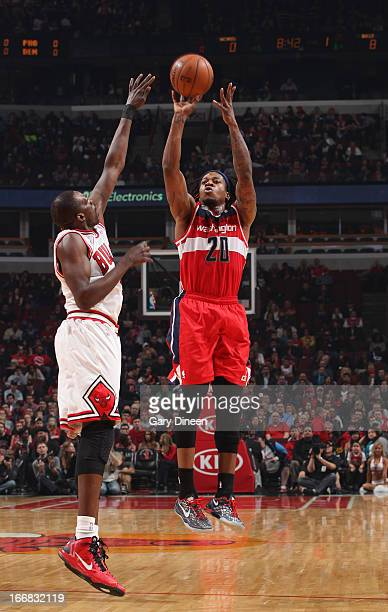 Cartier Martin of the Washington Wizards shoots against Luol Deng of the Chicago Bulls on April 17 2013 at the United Center in Chicago Illinois NOTE...