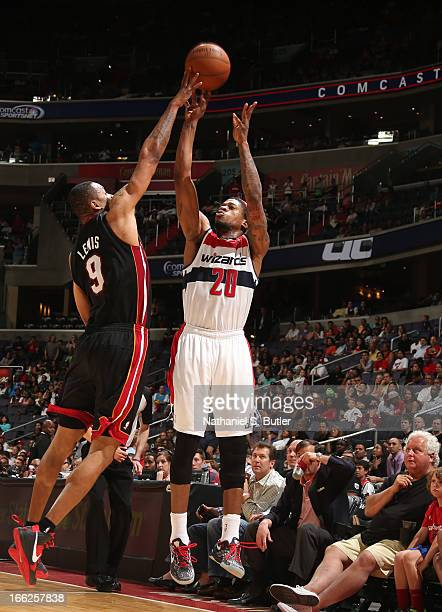 Cartier Martin of the Washington Wizards shoots against Rashard Lewis of the Miami Heat on April 10 2013 at the Verizon Center in Washington DC NOTE...