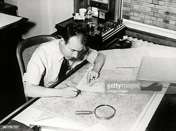 A cartographer at work circa 1930