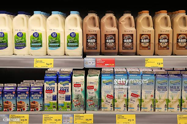 Cartons and bottles of milk products sit on display for sale at an Aldi Stores Ltd food store in Sydney Australia on Thursday June 25 2015...