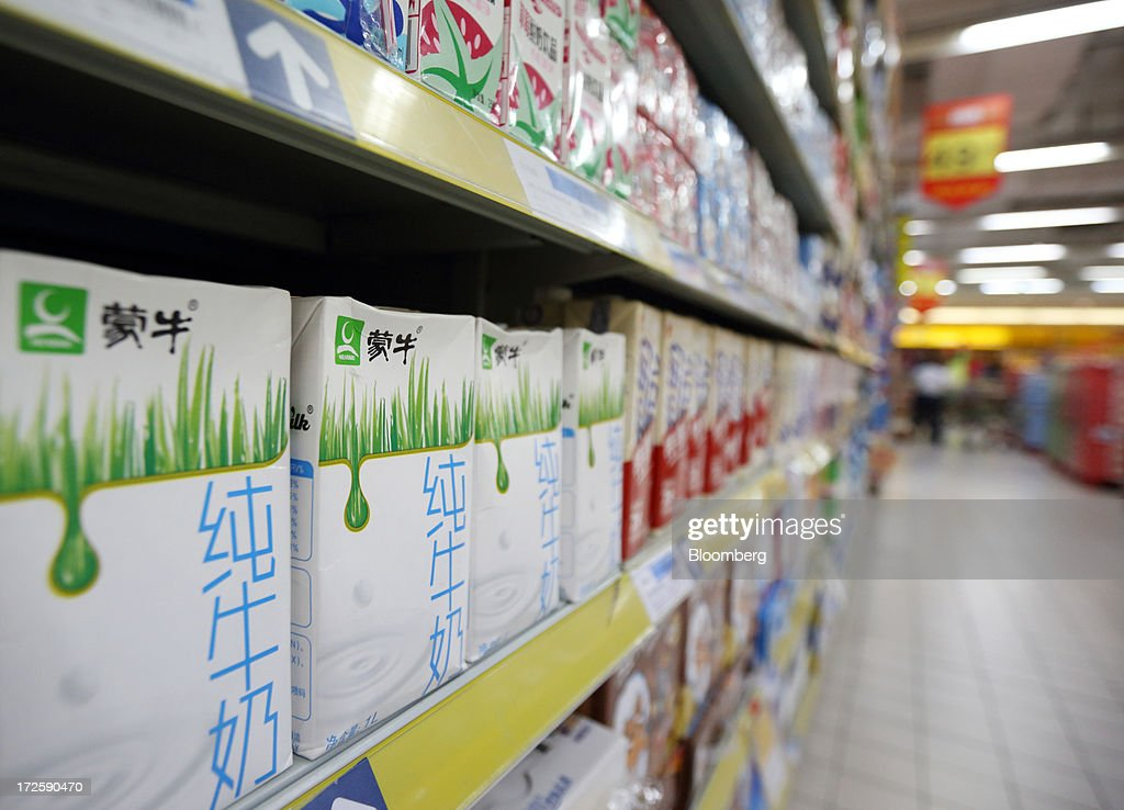 Cartons of China Mengniu Dairy Co. milk are displayed for sale at a store in Shanghai, China, on Tuesday, July 2, 2013. Banks including Goldman Sachs Group Inc. have pared their growth projections for China this year to 7.4 percent, below the government's 7.5 percent goal disclosed at the March conference at which Li Keqiang became premier. Photographer: Tomohiro Ohsumi/Bloomberg via Getty Images