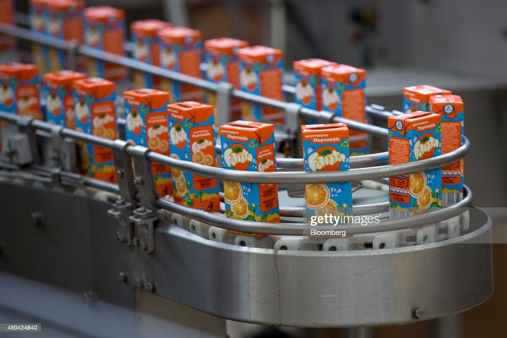 Cartons of Fanta orange drink travel along the production line during manufacture at the Lanitis Bros Ltd. bottling plant, part of the Coca-Cola Hellenic Group, in Nicosia, Cyprus, on Tuesday, June 10, 2014. Zug, Switzerland-based Coca-Cola Hellenic Bottling Co., which distributes Coca-Cola products in countries including Russia, wants to move away from using imported sugar for its Russian operations by 2015. Photographer: Andrew Caballero-Reynolds/Bloomberg via Getty Images