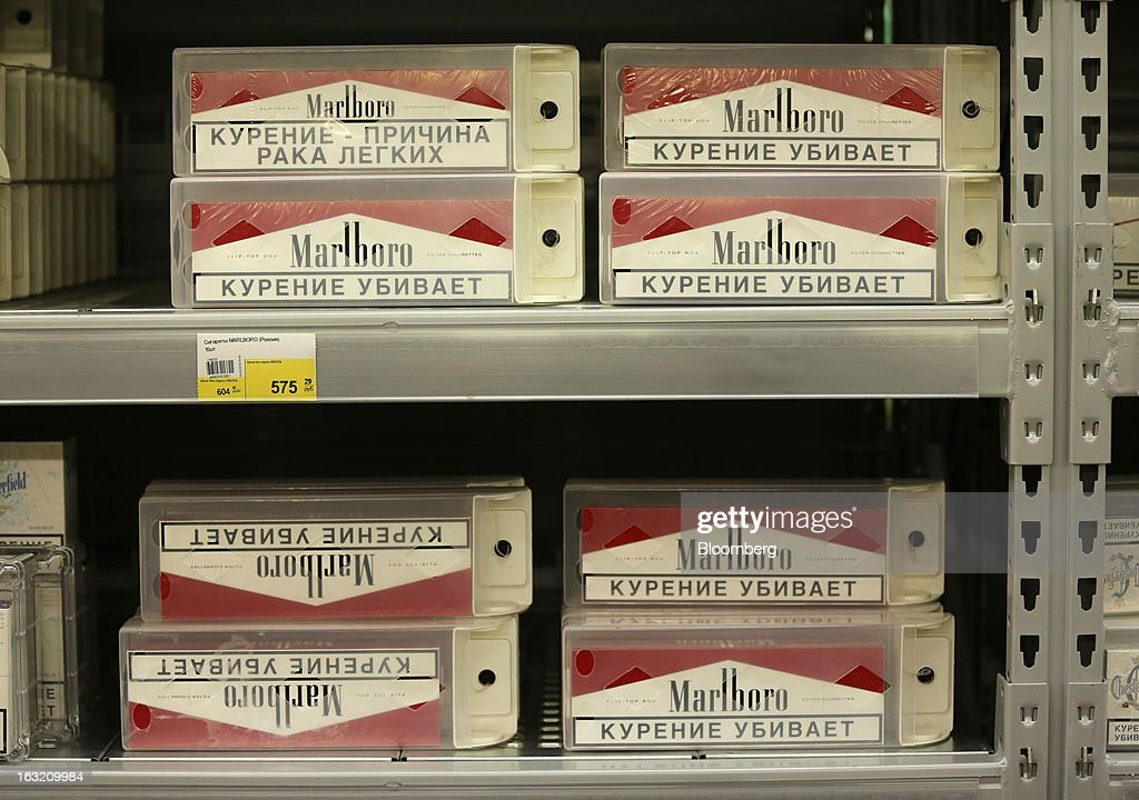 Cartons of Marlboro cigarettes sit for sale inside a Lenta LLC supermarket in Prokopyevsk, Kemerevo region, Russia, on Wednesday, March 6, 2013. Lenta LLC, a Russian hypermarket operator controlled by TPG Capital, is selling its first bond to expand after using company funds for a leveraged buyout by the U.S. firm. Photographer: Andrey Rudakov/Bloomberg via Getty Images