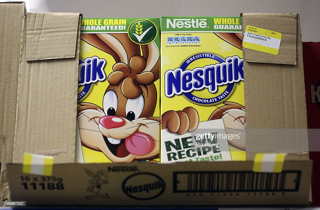 Cartons of Nesquik chocolate flavored breakfast cereal, produced by Nestle SA, sit in a box ahead of re-stocking at a supermarket in London, U.K., on Friday, Feb. 8, 2013. Britain's economy will grow more slowly this year than previously forecast and stagnation may persist, according to the National Institute of Economic and Social Research. Photographer: Chris Ratcliffe/Bloomberg via Getty Images