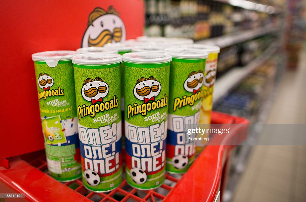 Cartons of Pringles potato chips, produced by Proctor & Gamble Co., sit on a branded display stand inside a Dixy supermarket operated by OAO Dixy Group in Moscow, Russia, on Tuesday, April 8, 2014. Suppliers suffering from ruble depreciation this quarter are urging retailers to increase prices. Photographer: Andrey Rudakov/Bloomberg via Getty Images