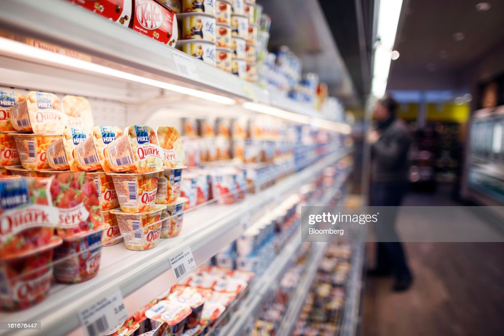 Cartons of Quark and other Nestle food products sit on display in a refrigerated cabinet inside a store at the Nestle SA headquarters in Vevey, Switzerland, on Thursday, Feb. 14, 2013. Nestle SA said it expects 2013 to be as challenging as last year, when sales missed analysts' estimates on a slowdown in emerging markets, a region the world's largest food company is increasingly dependent upon. Photographer: Valentin Flauraud/Bloomberg via Getty Images