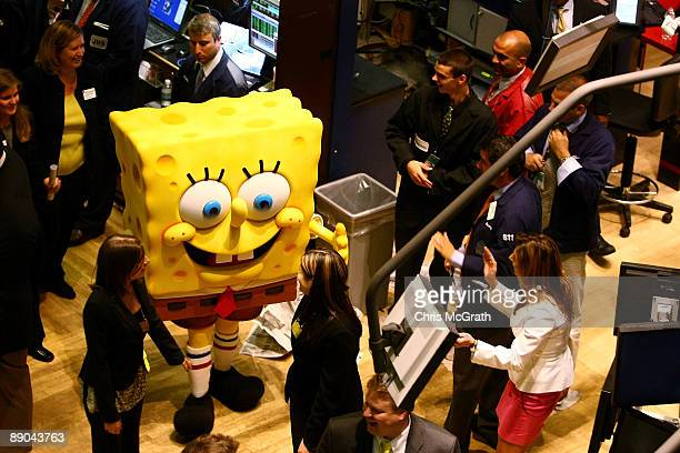 Cartoon character Spongebob Squarepants arrives on the trading floor to ring the closing bell at the New York Stock Exchange on July 15 2009 in New...