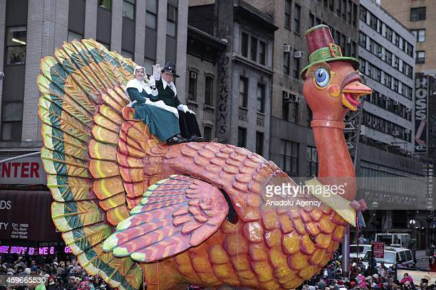 Cartoon characters attend the 88th Annual Thanksgiving Day Parade outside Macy's Department Store in Herald Square on November 27 2014 in New York...