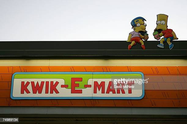 Cartoon characters sit atop a 711 convenience store converted into a 'KwikEMart' store from the longrunning television cartoon show 'The Simpsons' to...