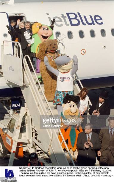 Cartoon characters were on hand for the grand opening of the new airline JetBlue Airways at John F Kennedy Airport in New York February10 2000 The...