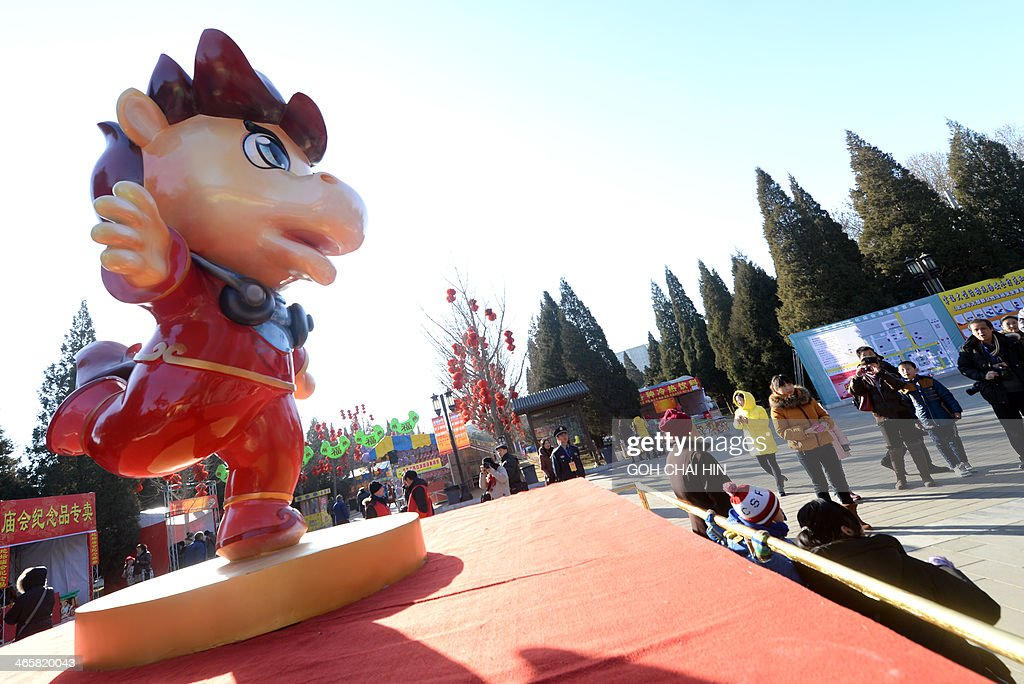 A cartoon horse welcomes visitors to the Ditan park temple fair in Beijing on January 30, 2014, on the eve of the Lunar New Year. Over a billion Chinese in China and millions more all over the world will be celebrating the Lunar New Year, known as the Spring Festival in China.