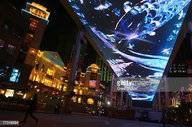 A Cartoon is displayed on the largest LED screen in the world at the 'The Place' shopping mall on October 10 2007 in Beijing China The screen...
