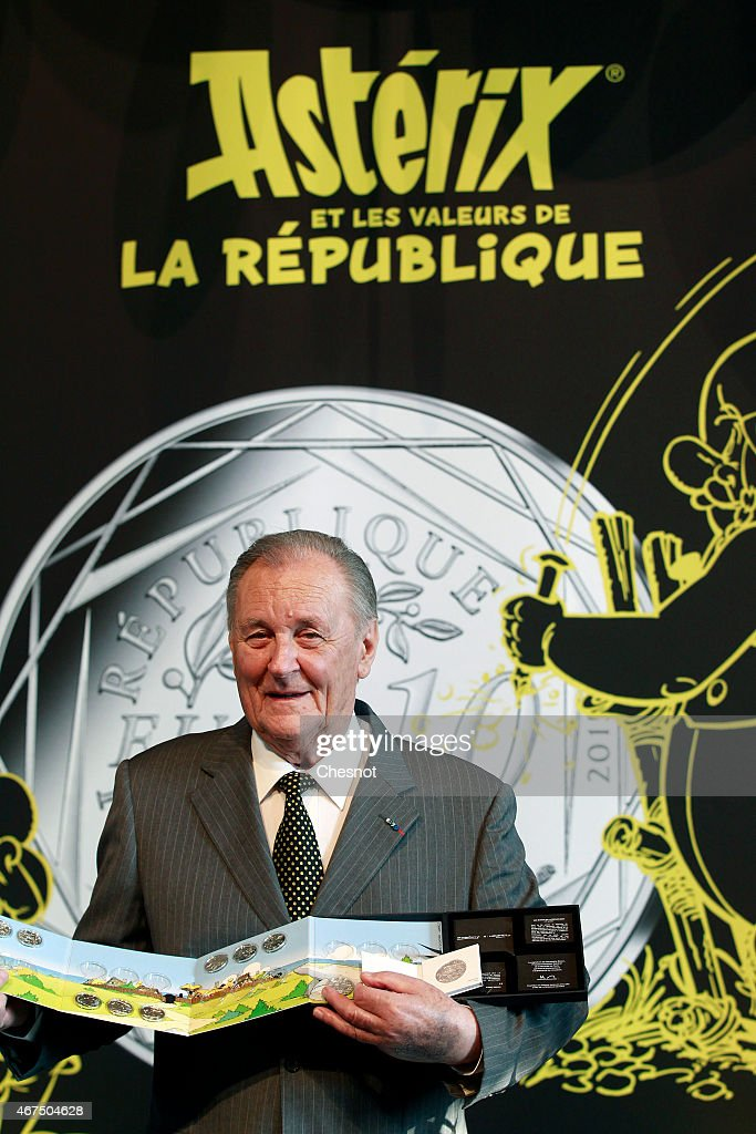 Cartoonist <a gi-track='captionPersonalityLinkClicked' href=/galleries/search?phrase=Albert+Uderzo&family=editorial&specificpeople=2121085 ng-click='$event.stopPropagation()'>Albert Uderzo</a> of France poses with a new series of twelve coin pieces illustrated with Asterix prior to a press conference at the Monnaie de Paris on March 25, 2015, in Paris, France. A new twelve piece coin series illustrated with Asterix entitled 'Asterix and the values of the Republic' was presented in Paris.