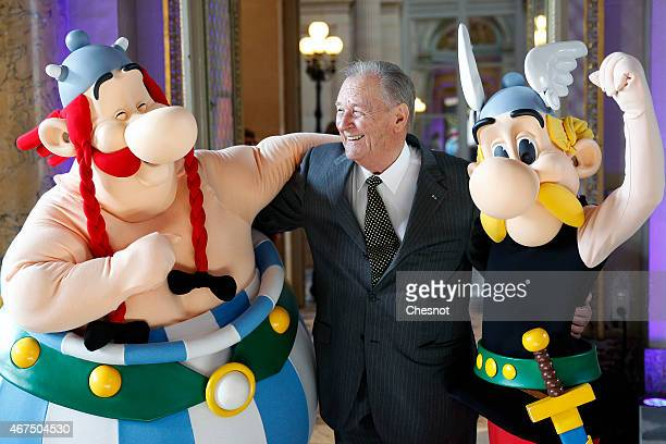 Cartoonist Albert Uderzo of France poses with Asterix and Obelix prior to a press conference at the Monnaie de Paris on March 25 in Paris France A...