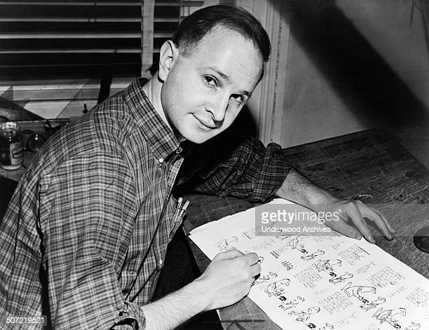Cartoonist author playwright and Pulitzer Prize winner Jules Feiffer working on proof sheets from his first book 'Sick Sick Sick' New York New York...