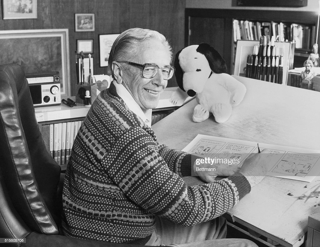 Cartoonist <a gi-track='captionPersonalityLinkClicked' href=/galleries/search?phrase=Charles+M.+Schulz&family=editorial&specificpeople=997865 ng-click='$event.stopPropagation()'>Charles M. Schulz</a>, creator of the 'Peanuts' comic strip, draws in his studio near a stuffed Snoopy toy. His comic strip was celebrated in the 1985 television program 'It's Your 20th Television Anniversary, Charlie Brown.'