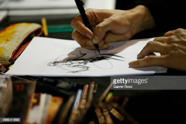 A cartoonist draws during Argentina ComicCon 2015 at Costa Salguero Center on November 06 2015 in Buenos Aires Argentina