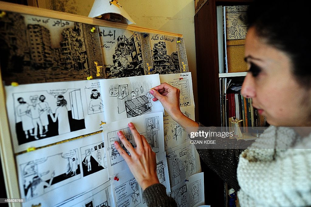 Cartoonist Hala Ismail works about cartoons about Islamic State members at her home office on January 25 2015 in Gaziantep south east Turkey a city...
