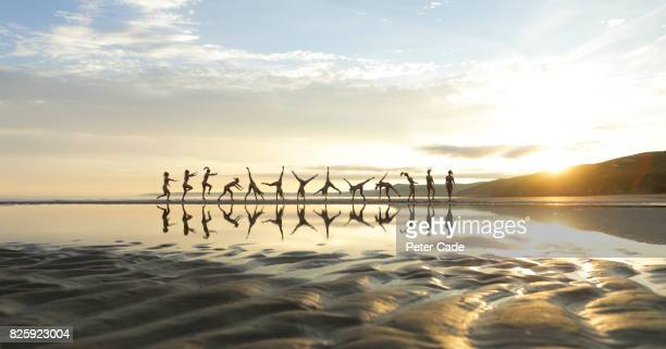 Cartwheel on beach at sunset