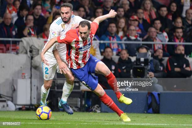 Carvajal #2 of Real Madrid and Diego Godin #2 of Atletico de Madrid during The La Liga match between Club Atletico Madrid v Real Madrid at Wanda...