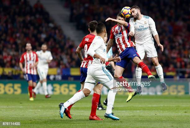 Carvajal and Gabi compete for the ball during the La Liga match between Atlético de Madrid and Real Madrid