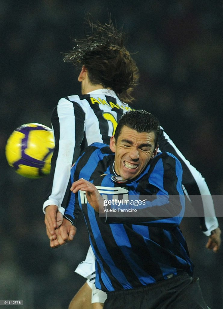 Carvalho De Oliveira Amauri of Juventus FC clashes with Da Silva Ferreira Lucio of FC Internazionale Milano during the Serie A match between Juventus and Inter Milan at Olimpico Stadium on December 5, 2009 in Turin, Italy.