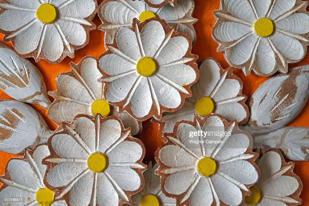 Carved and painted wooden flowers